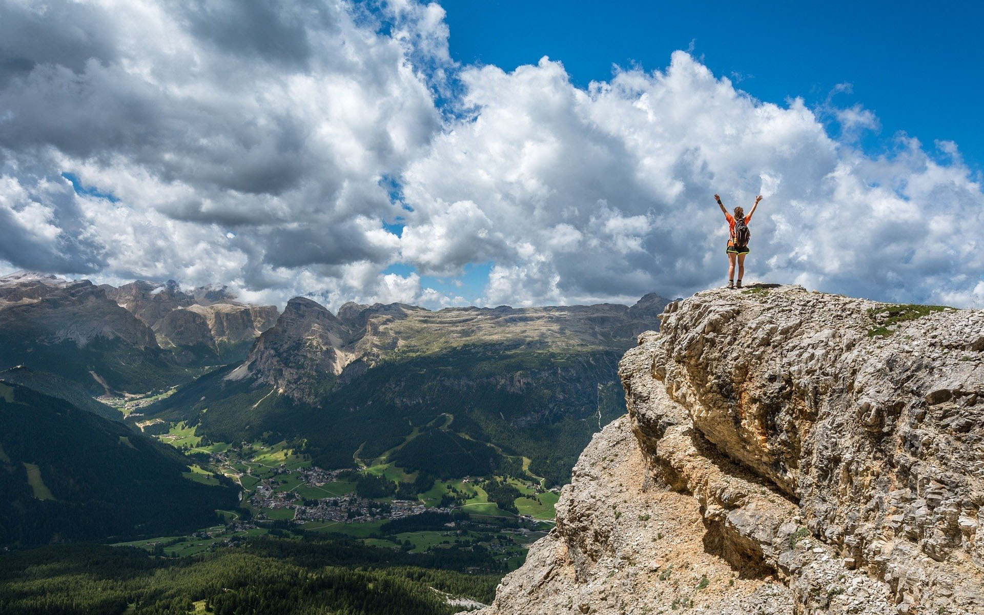 Person on a mountain peak for a blog about national management training week